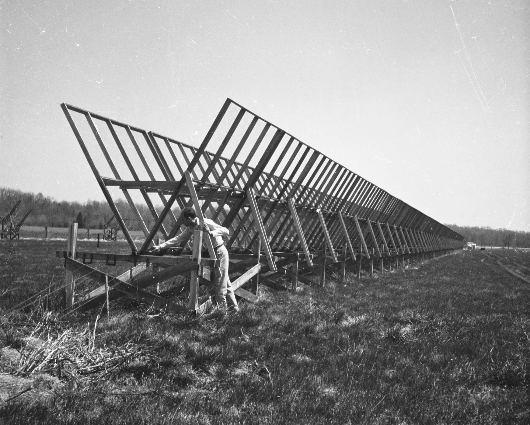 John W. Firor working on the Precise Position Apparatus, one of several radio telescopes built at DTM's River Road site, ca. 1959.