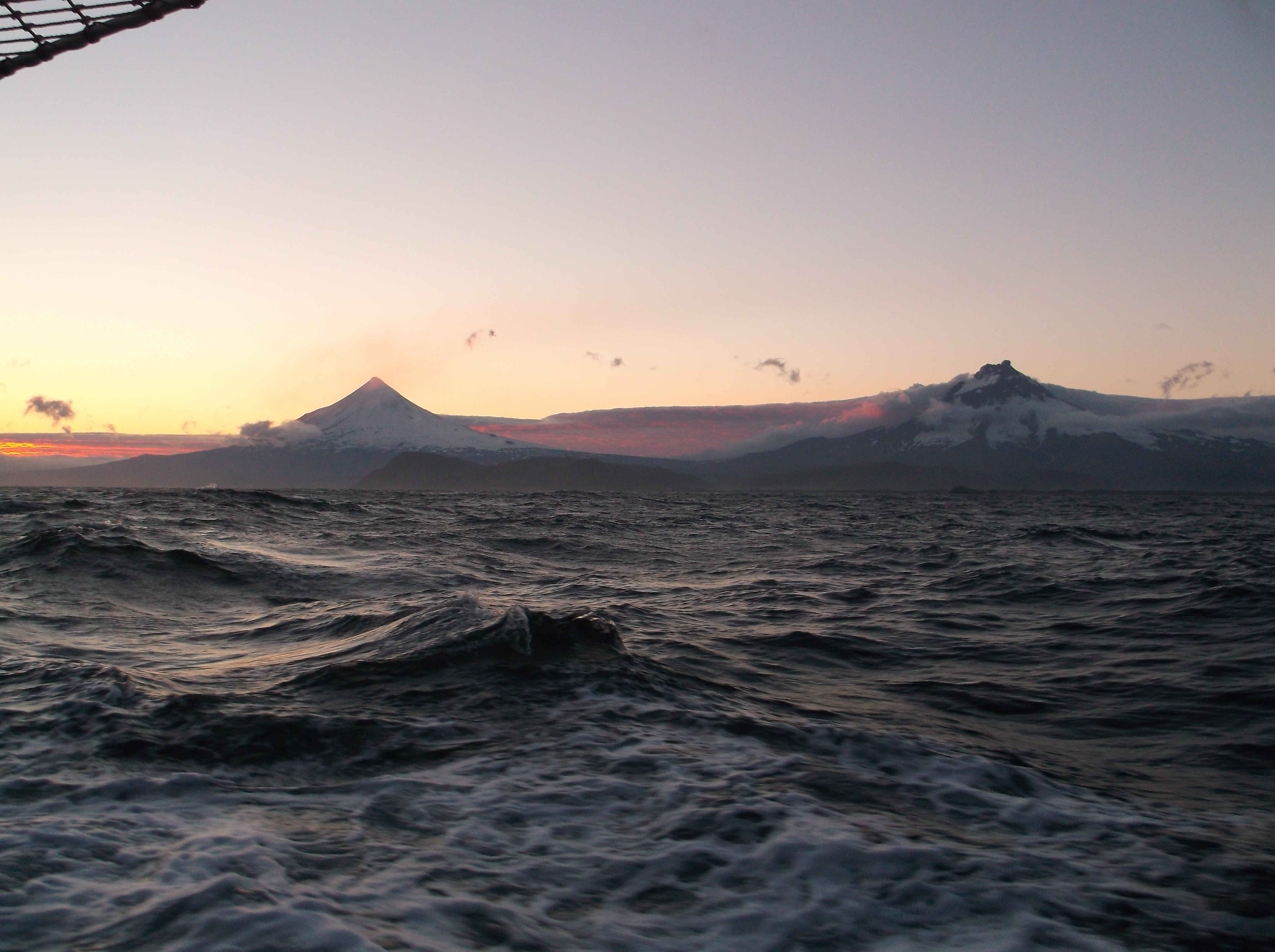 Photo of Cleveland Volcano (right) and neighboring Carlisle (left) from a boat. Photo by Diana Roman. I have never been to or seen Cleveland, unfortunately.