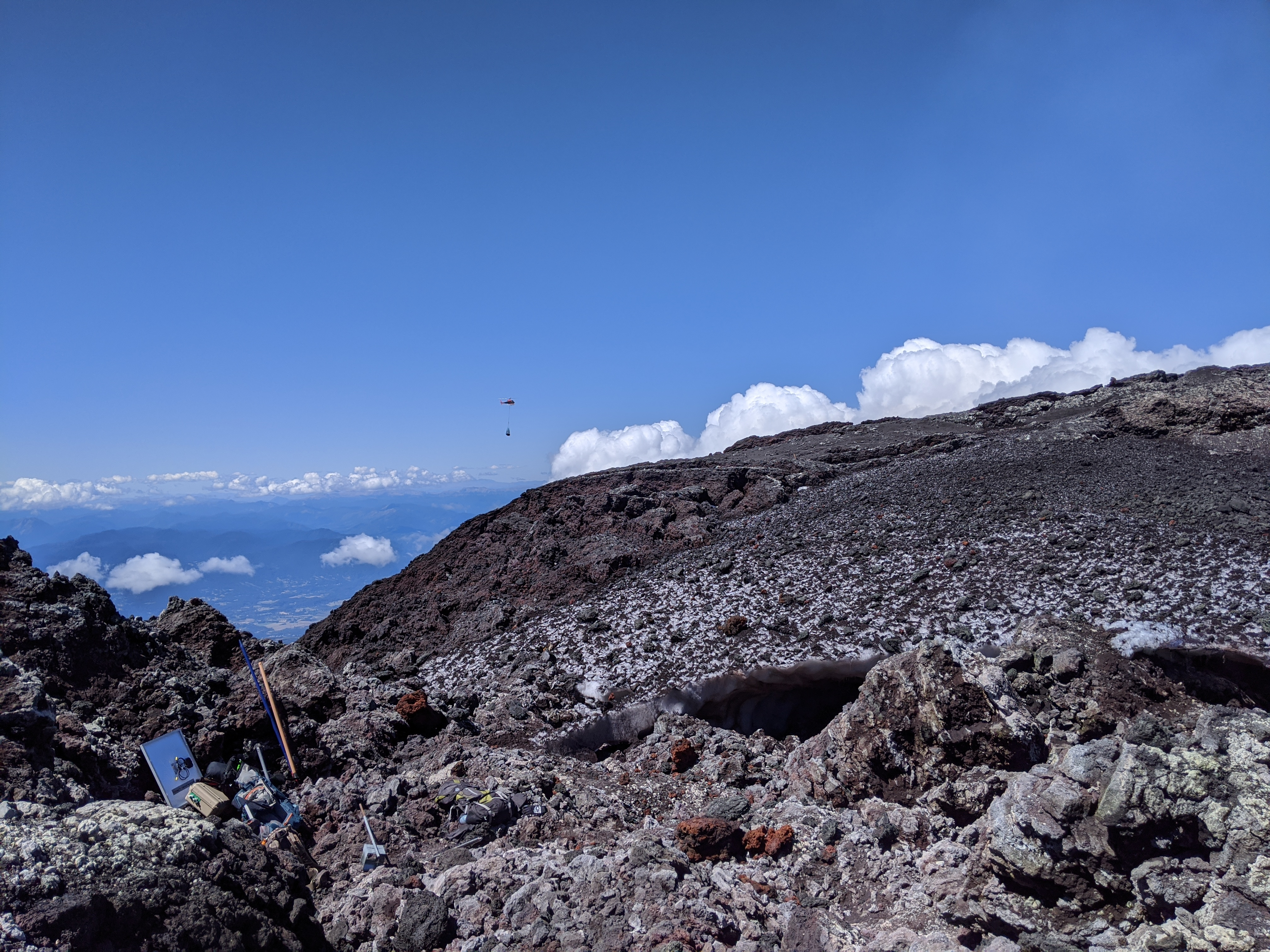 Natural Laboratory on Villarrica - Tools on Volcano with Helicopter in the Distance
