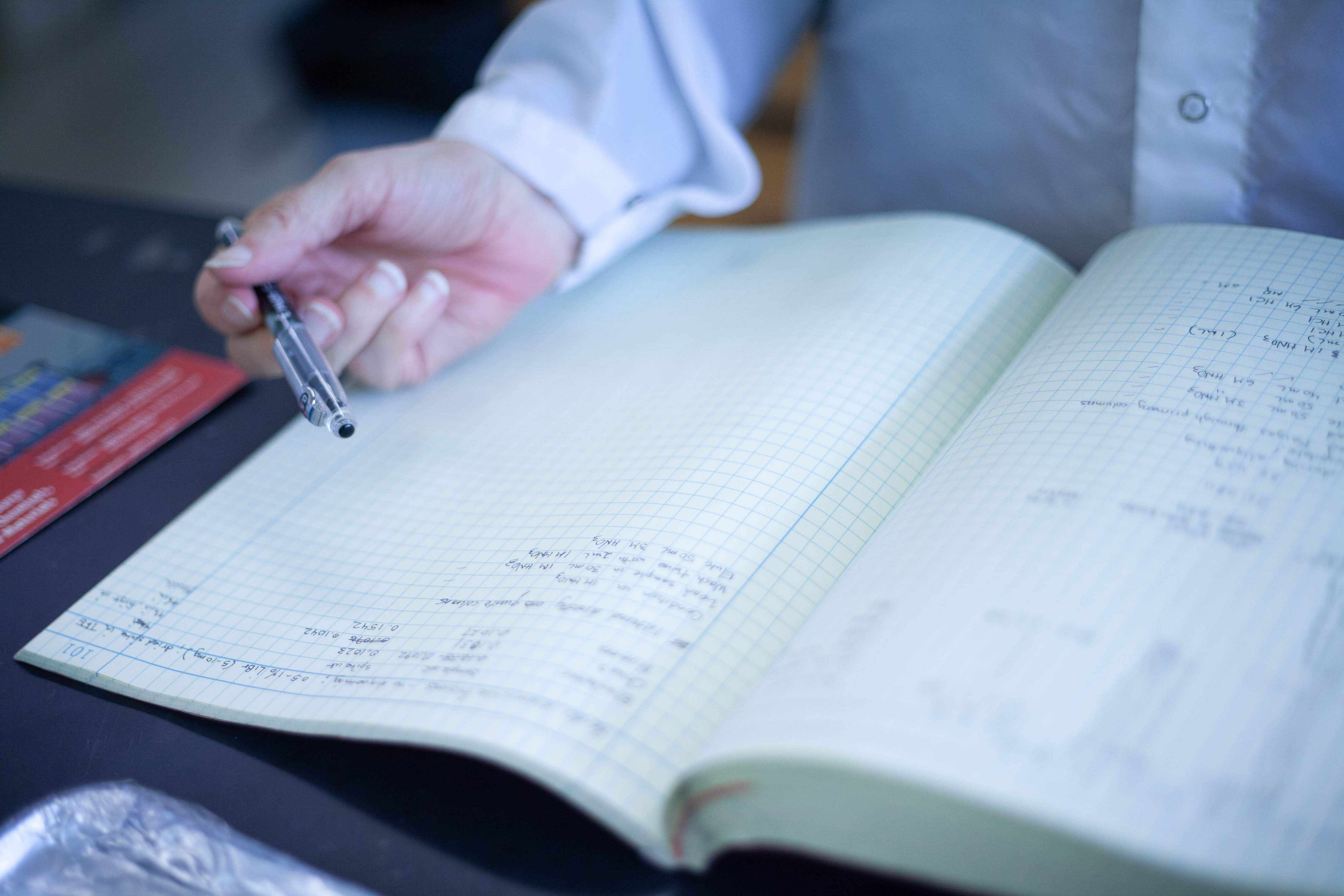 Mary Horan takes notes in her laboratory notebook