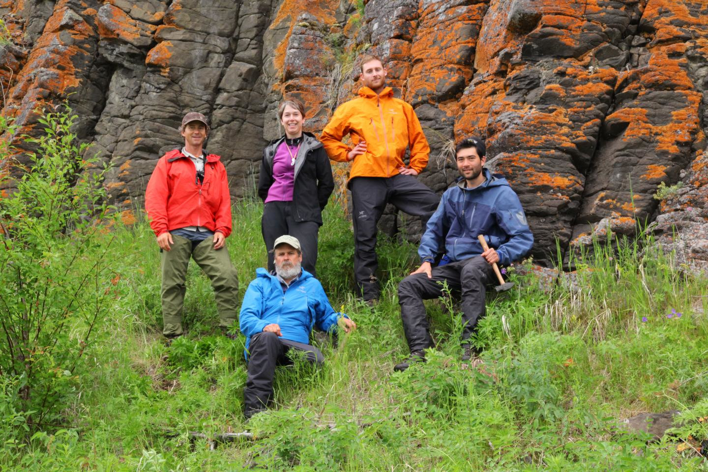 Linda Elkins-Tanton and her fieldwork team pose in front of columnar basalt from the Siberian flood basalts on an island in the Angara river.