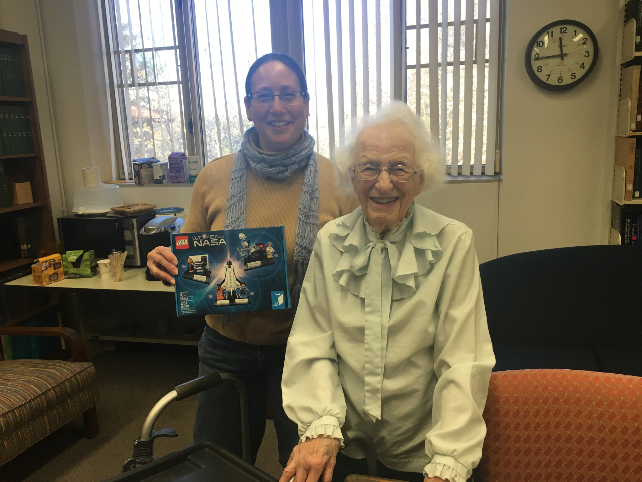Alycia Weinberger (left) and Nancy Grace Roman (right) meet on the Earth and Planets Laboratory campus after an astronomy seminar. Roman had just signed Weinberger's Lego Women of NASA set. Photo Credit: Adriana Kuehnel
