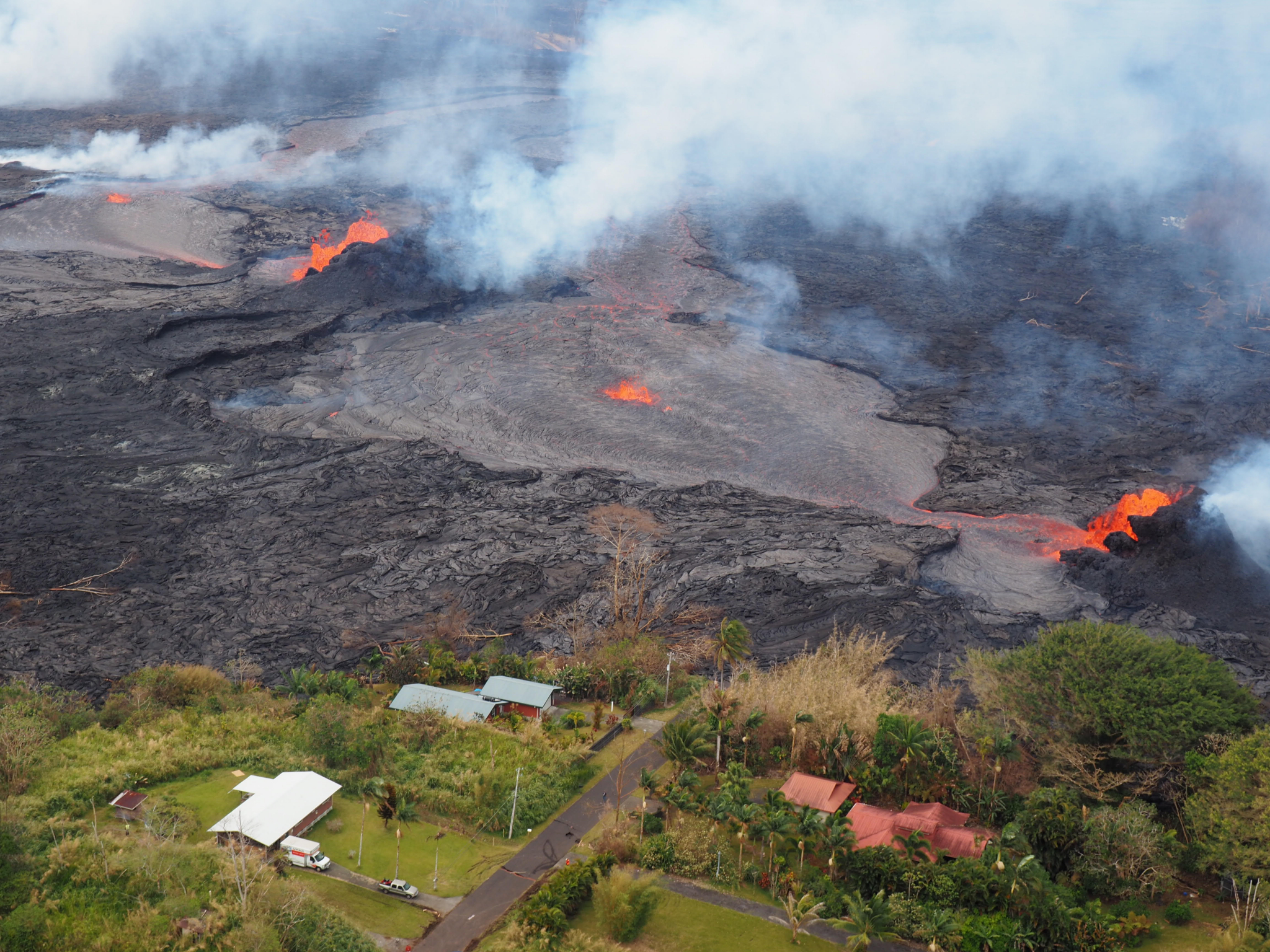 n May 2018, eruptive fissures opened and deposited lava within the Leilani Estates subdivision on the Island of Hawaii. Over 700 homes were destroyed, displacing more than 2000 people. (credit: B. Shiro, USGS)