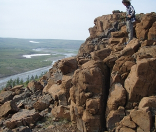Siberian Traps Project team member overlooks the ca 252 Ma Siberian large igneous province. (Photo by Linda Elkins-Tanton)
