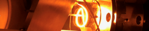 Glowing coiled filament used as a source of energetic electron