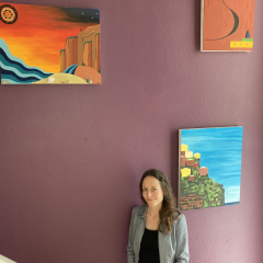Anne Pommier with her artwork